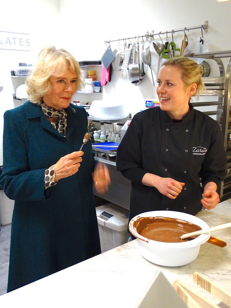 Camilla is shown how chocolates are made by Zara
